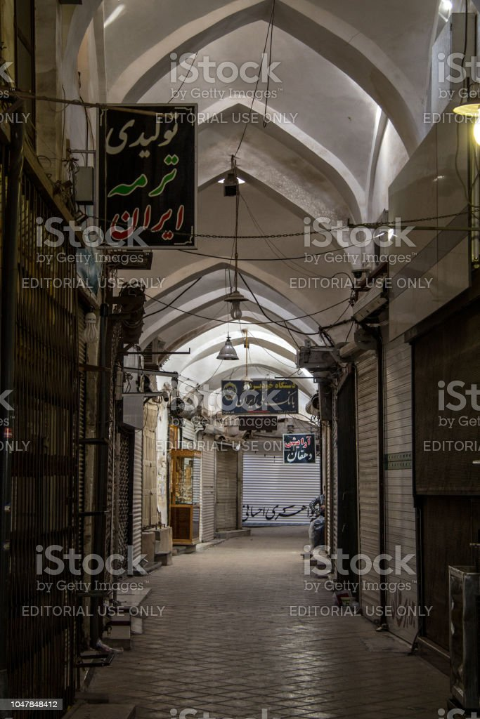 Street of the Yazd Khan bazar in the afternoon, empty and deserted, in a covered alley of the market. Symbol of the Persian architecture, it's a major landmark of the city stock photo