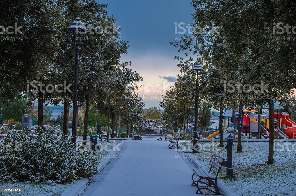 Street park with snow stock photo
