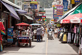 """""""Phuket, Thailand - July 30, 2011: Street Patong beach with shops, services, and mobile kitchens with Thai food. The street is always tourists. A lot of hotels."""""""
