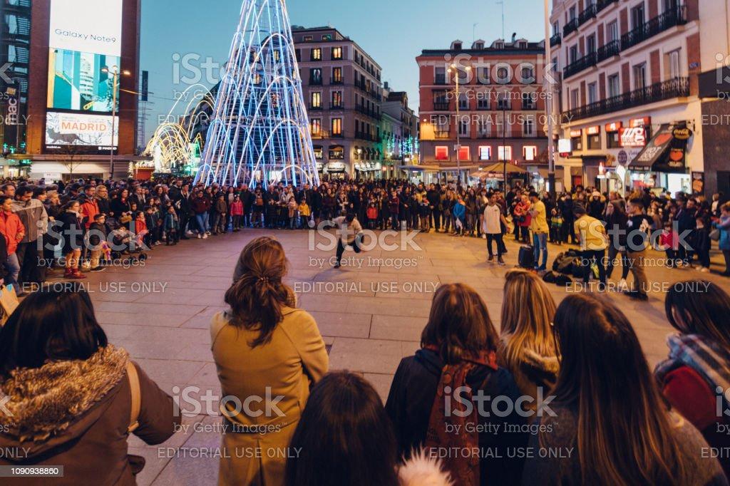 street performance draws a crowd stock photo