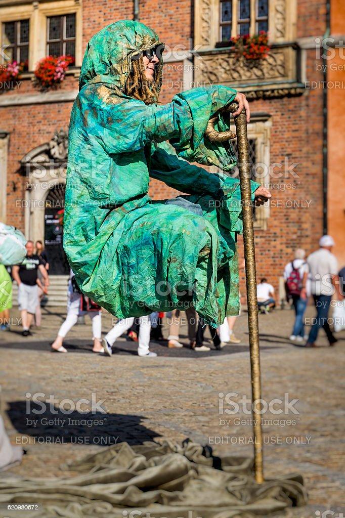Street Performer imitating old monk levitates on famous Old Market...