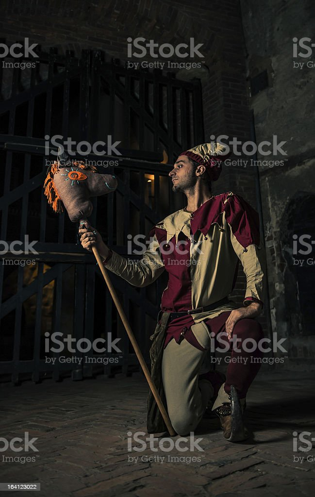 Street Performer Jester with Horse Puppet royalty-free stock photo