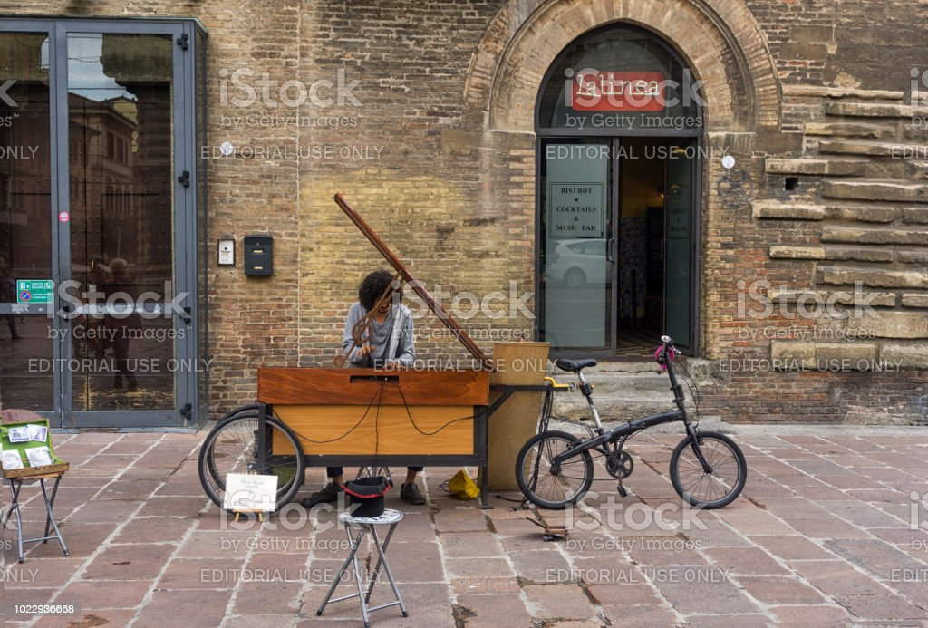 Street performer playing a portable piano stock photo