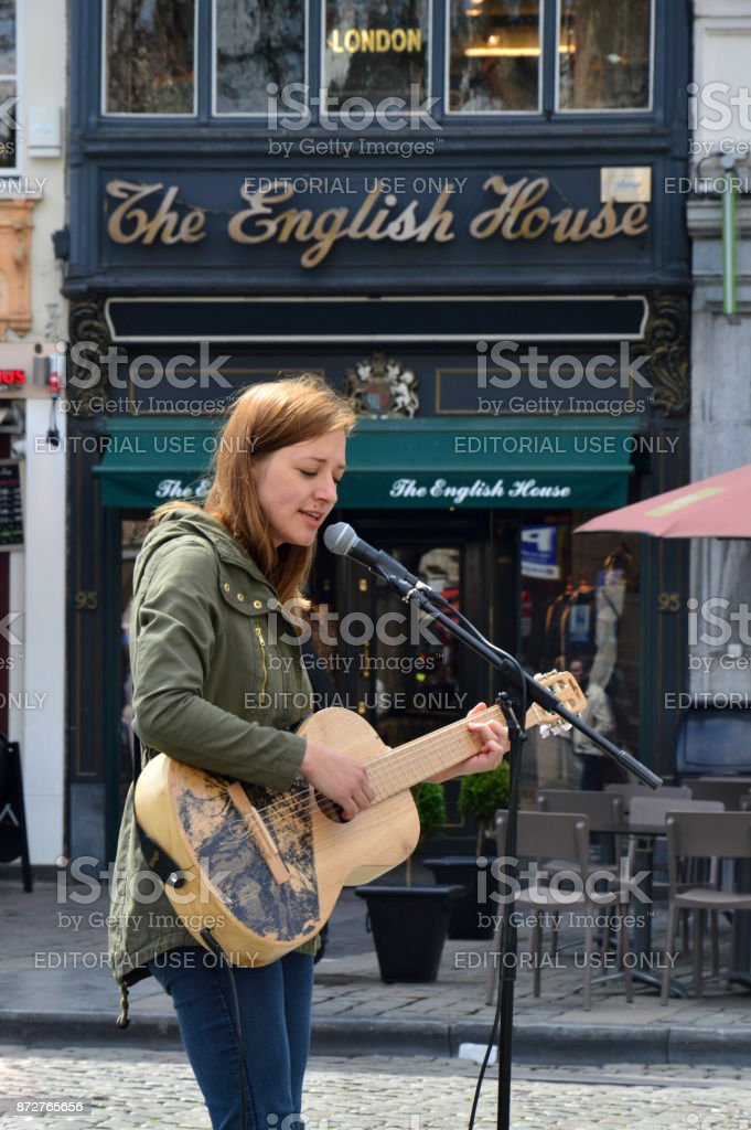 Street performer singing at Grass Market, Agora Square near Grand Place in Brussels, Belgium stock photo