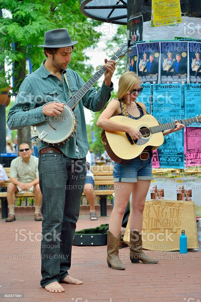 Typical street scene with street musicians playing for a variety of...