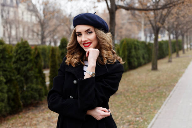 Street photo of young beautiful woman wearing stylish classic clothes. emotions, people, beauty and lifestyle concept - Girl Frenchwoman. Street photo of young woman wearing stylish classic clothes. Female fashion concept. French style. beret stock pictures, royalty-free photos & images