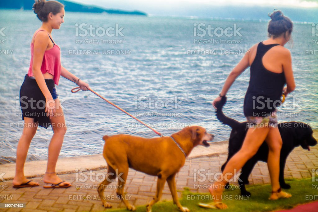 Street photograph documenting the daily life of beach life in Ilhabela, Brazil. stock photo