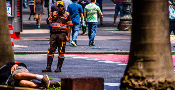 Street photography documenting in an artistic way the urban daily life in the city of São Paulo, Brazil. Selective focus. Special lens, large aperture and tilt-shift built by the photographer. stock photo