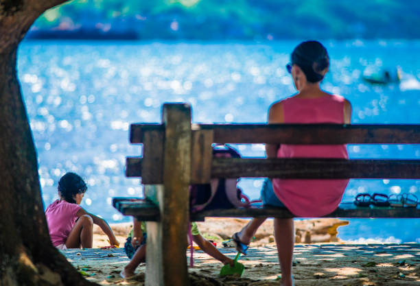 street photography documenting the daily life of the beach in Ilhabela, Brazil stock photo