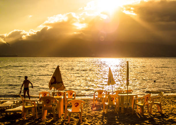 street photography documenting the daily life of the beach in Ilhabela, Brazil. stock photo