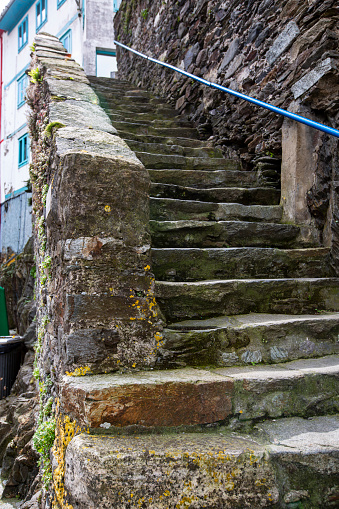 istock street photography of an old stone staircase filled with moss 1214785483