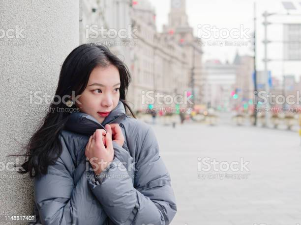 Street photography of beautiful young brunette woman in sunny winter picture id1148817402?b=1&k=6&m=1148817402&s=612x612&h=yaw 8qqazzltv7n8ywfbhpwdovwnbxanprj8 utdm5a=
