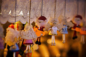 Krakow, Poland - December 08, 2014: Street photography of souvenir shops and items kept in it for tourists in Main square center of city during Christmas