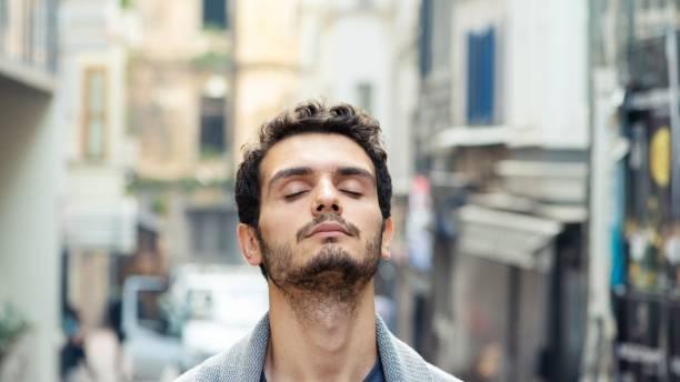 Street portrait of millennial man in his 20s stock photo