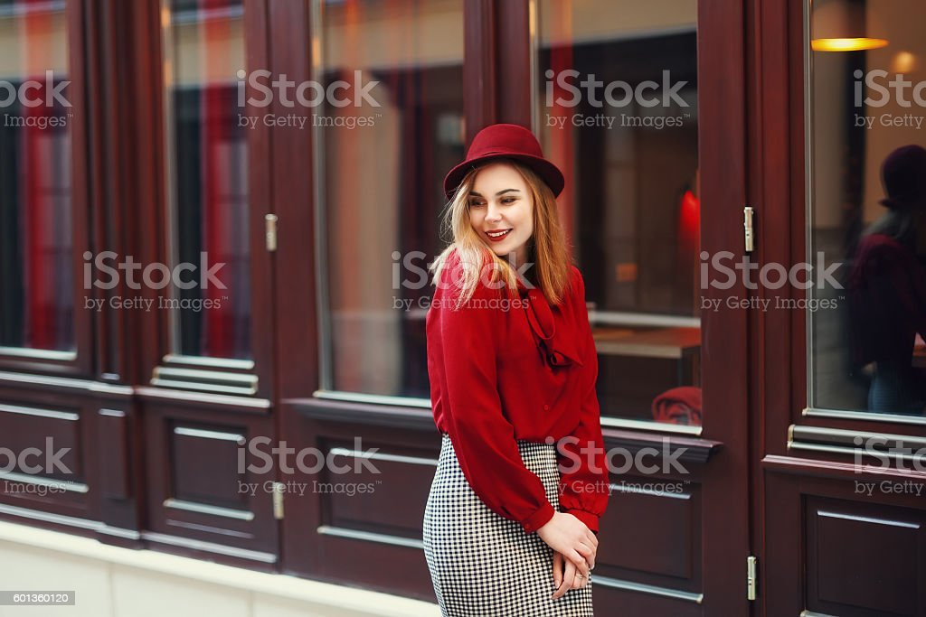 Street portrait of young beautiful happy smiling woman wearing stylish stock photo