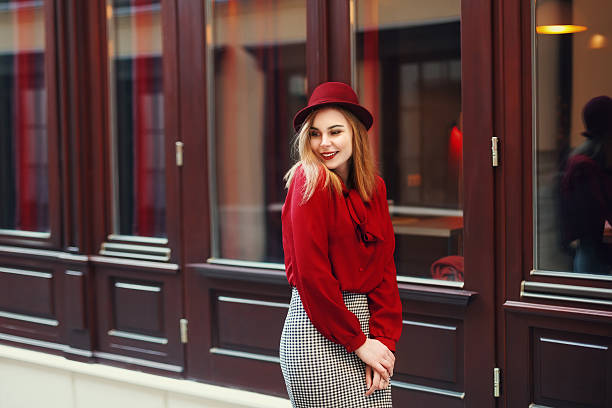 Street portrait of young beautiful happy smiling woman wearing stylish Street portrait of young beautiful happy smiling woman wearing stylish classic clothes. Model looking aside. Female fashion concept. Copy space, free text. Toned. blouse stock pictures, royalty-free photos & images