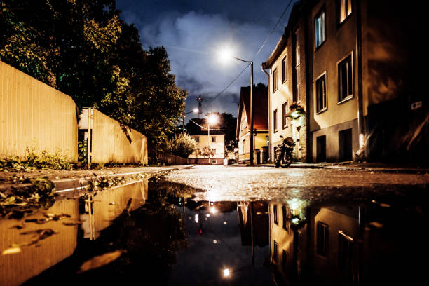 Street reflected in puddle - Tallinn, Estonia stock photo