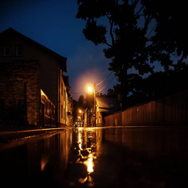 Street reflected in puddle - Tallinn, Estonia stock photo
