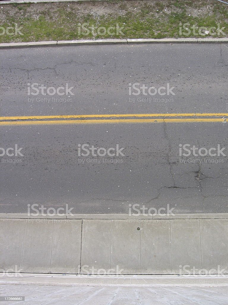 Street Road - Bending yellow lines from above royalty-free stock photo