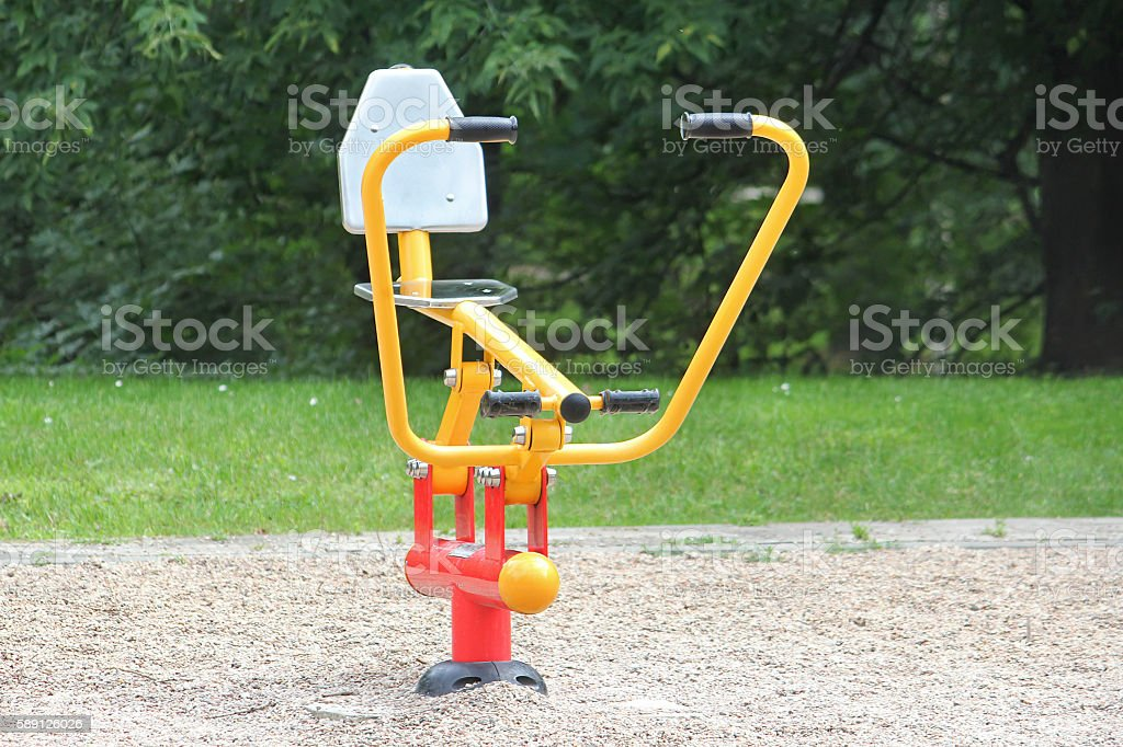 Street rowing machine in the park for outdoor workouts stock photo