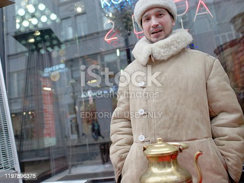 Moscow, Russia - January 06, 2020: selling hot tea from the big samovar in the street