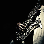 detail of a saxophonist with his instrument
