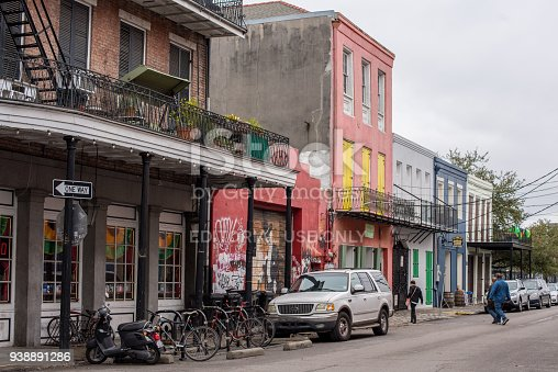 938895626 istock photo Street scene along Frenchman Street in New Orleans 938891286