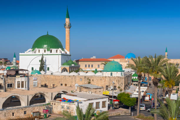 Street scene and the Al Jazzar Mosque in the old city of Akko (Acre), Israel. stock photo