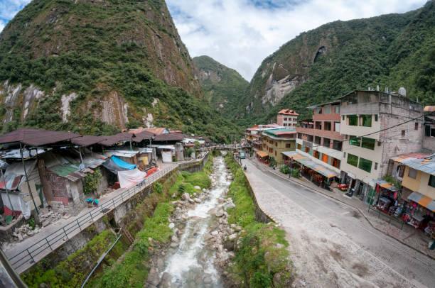 Street Scene and the Urubamba River In Aguas Calientes, Peru stock photo