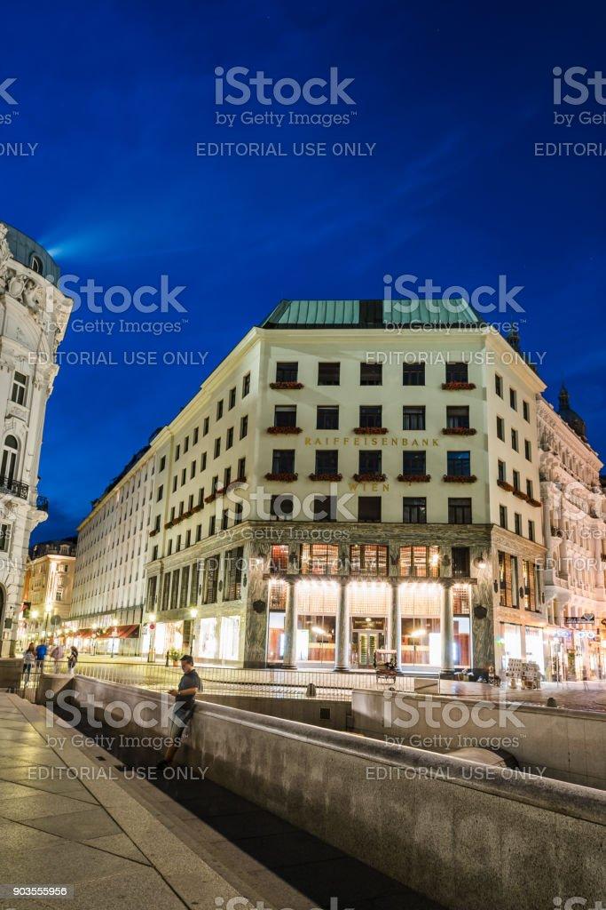 Street scene at night in Vienna in Michaelerplatz with Looshaus stock photo