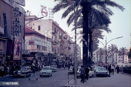 Beirut, Lebanon, 1964. Street scene at the Place des Martyrs in Beirut. Furthermore: pedestrians, cars, buildings, advertising, cinema and shops.