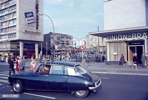 Berlin, Germany, 1963. Street scene with pedestrians and cars at the intersection Joachimsthalter Str. corner Hardenbergstr. in the former West Berlin (city west).
