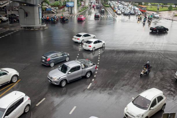 street scene in bangkok, thailand - motorbike, umbrella stock photos and pictures