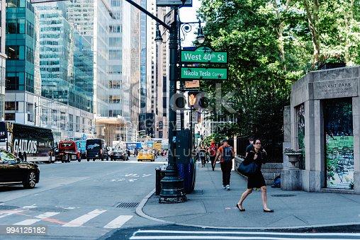 New York City, USA - June 20, 2018: Street scene in corner in Bryant Park in New York City.