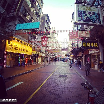 Kowloon, Hong Kong - January 15, 2015: A street view of Kowloon, Hong Kong, China. People are walking along the street. Colorful street has lots of signboards in Chinese. Photo taken with Apple iPhone 5s.