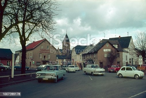 Horhausen, Altenkirchen, Rhineland Palatinate, Germany, 1969. Street scene in Horhausen. Furthermore: houses, traffic signs and a church tower.