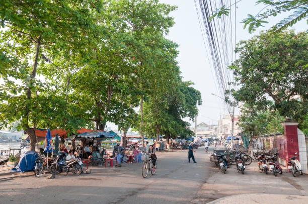 street scene in my tho, vietnam - motorbike, umbrella stock pictures, royalty-free photos & images
