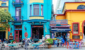 Istanbul, Turkey-October 5, 2018: Tourists are sitting outside cafes and restaurants in this colourful street in the Sultanahmet district.