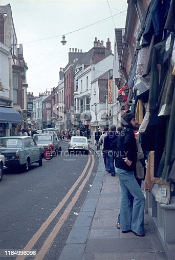 Dover, County Kent, England, UK, 1976. Street scene with pedestrians, traffic, shops and buildings in the south English town of Dover.