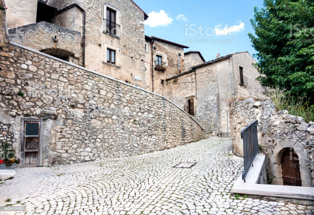 Street scene of ancient buildings, arched doorways and cobblestone streets in the tiny medieval fortified village of Santo Stefano di Sessanio; Gran Sasso National Park; L'Aquila Province, Abruzzo; Italy; Europe stock photo