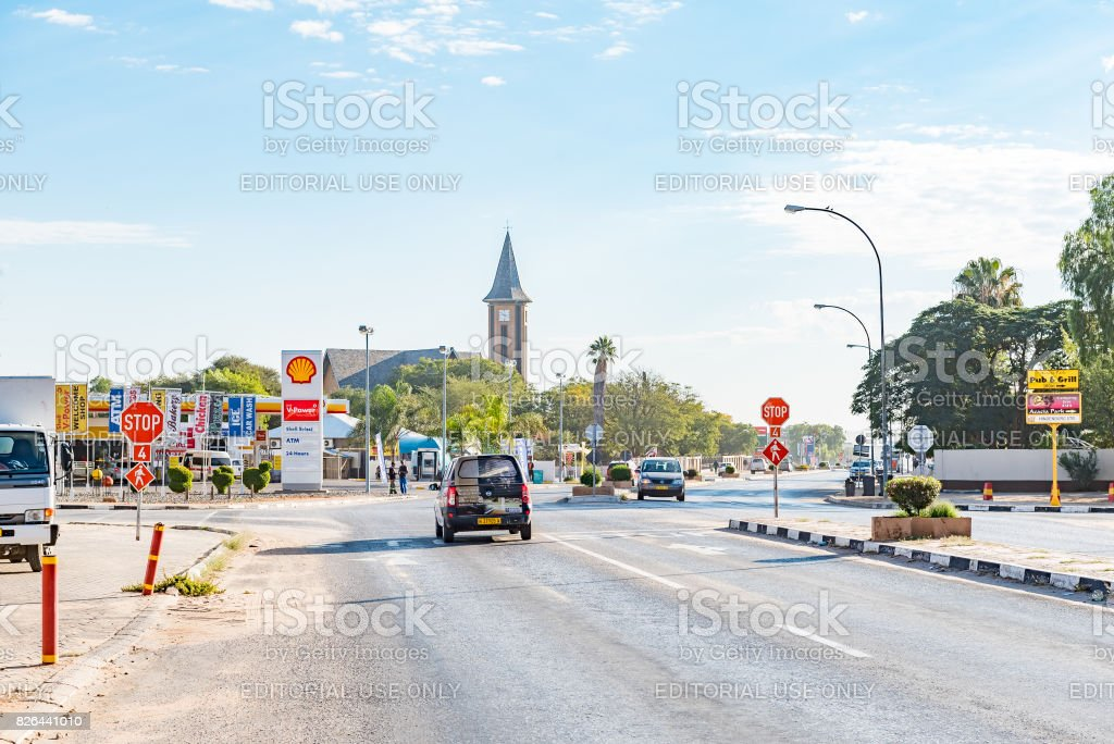Street scene with businesses and Dutch Reformed Church in Otjiwarongo stock photo