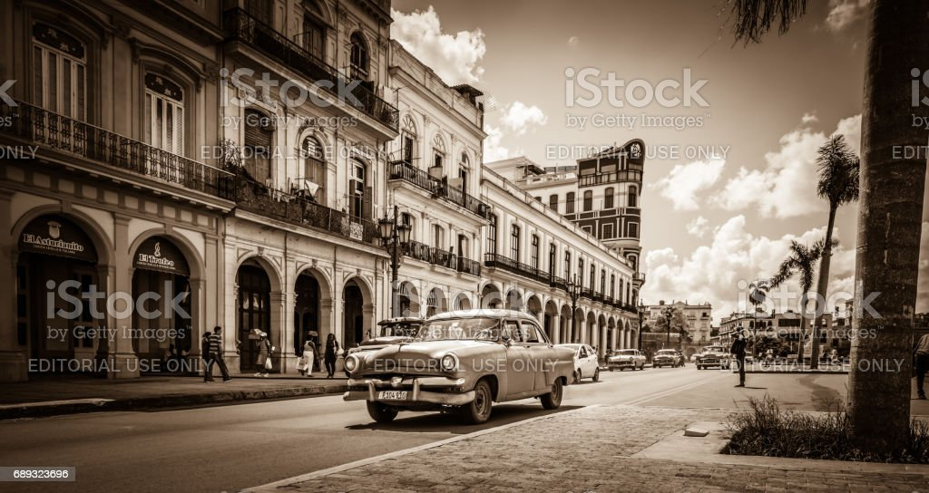 Street scenery on the main street with drive American vintage cars in...