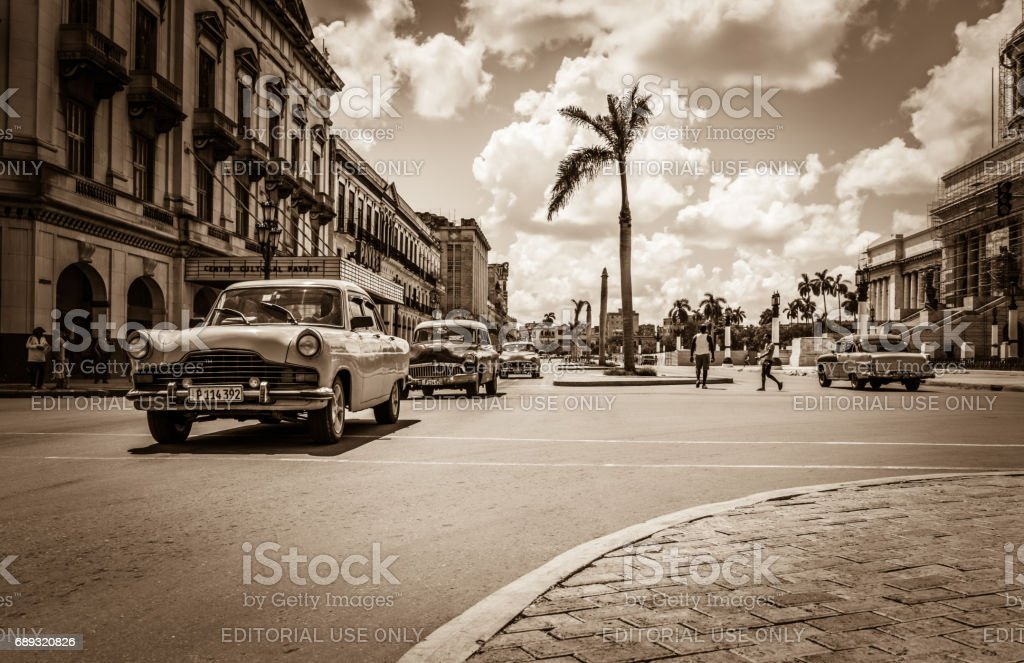 HDR - Street scenery with drived american vintage cars on the main street in Havana City Cuba - Retro Serie SEPIA Cuba Reportage stock photo