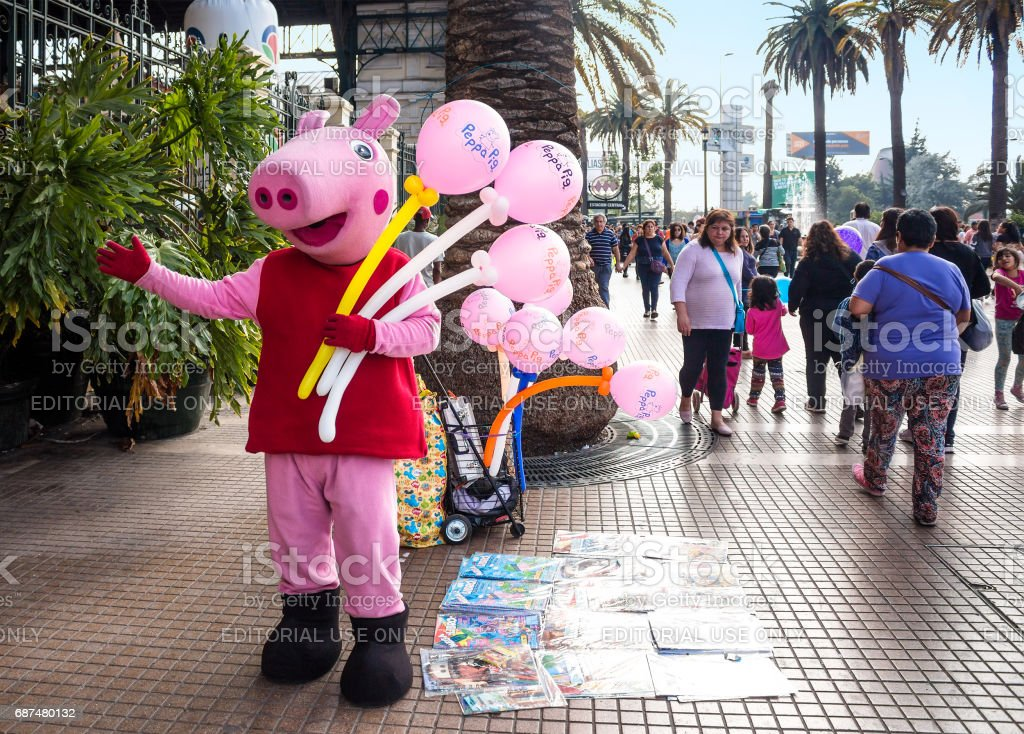 Street seller in Peppa Pig costume near Central Station in Santiago, Chile stock photo