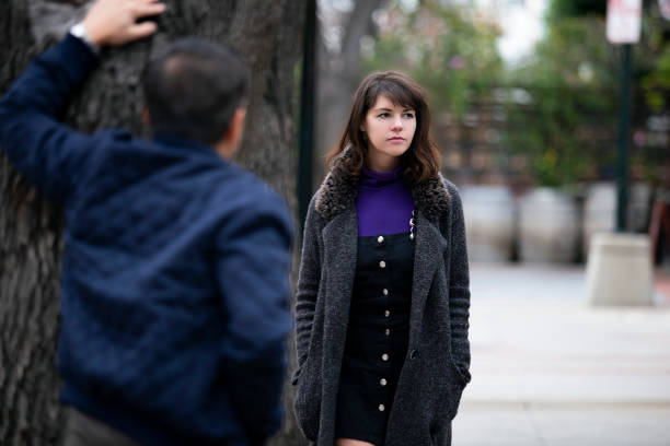 Street Sexual Harassment or a Criminal Stalking Female Victim stock photo
