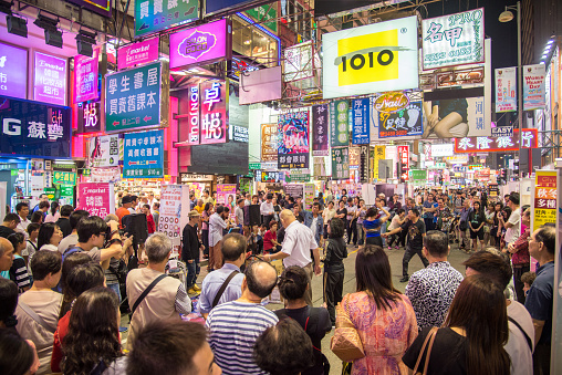 Street Show On Mongkok Area Mong Kok Is Characterized By A Mixof Old And New Multistory Buildings Stock Photo - Download Image Now