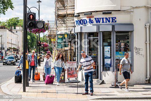 istock Street sidewalk corner in Pimlico district neighborhood area by vintage retro convenience store with Denbigh Food and wine sign on sunny day 1097420722