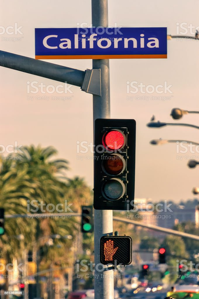 Street sign and red light in California Avenue, Santa Monica, USA. stock photo