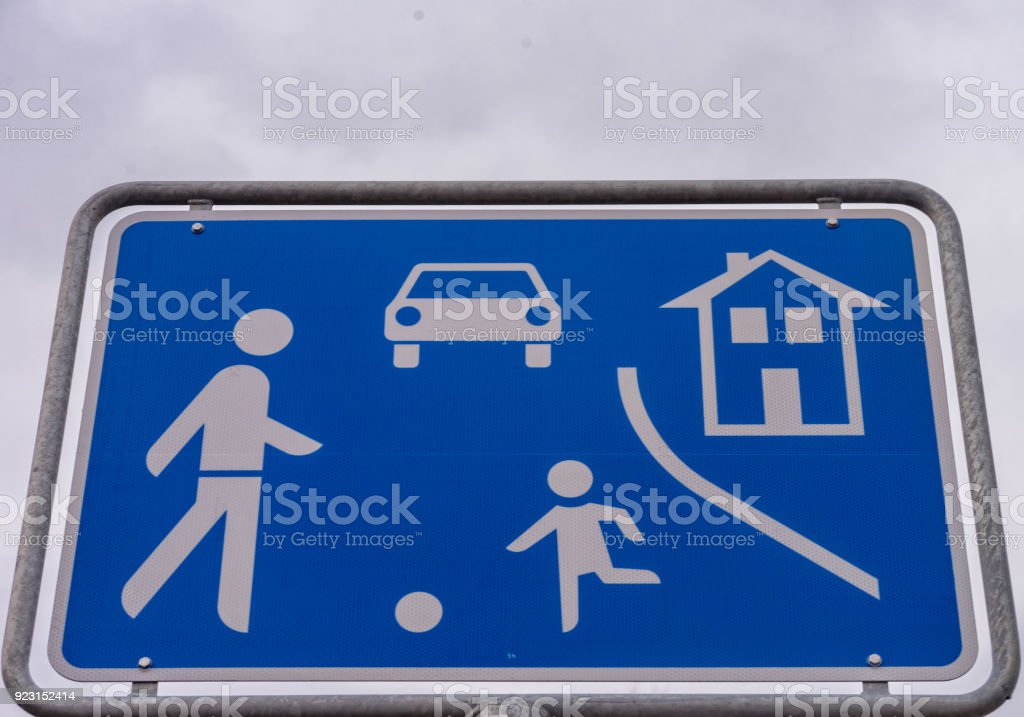 Street sign from a game road beside a road stock photo