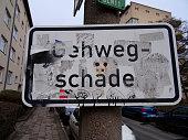 BERLIN - January 2019: Street sign pavement damage
